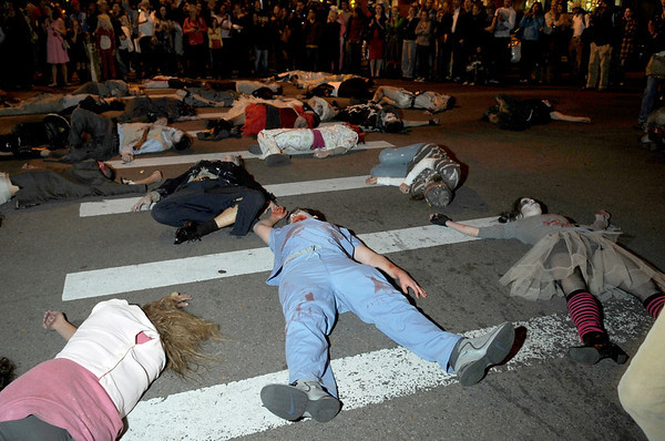 "Bodies lay in the crosswalk of 10th and Pearl while they wait to be revived by music during Michael Jackson's ""Thriller"" on Saturday, Oct. 30.<br /> For more photos go to  <a href=""http://www.dailycamera.com"">http://www.dailycamera.com</a><br /> Jeremy Papasso"