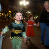 Walker and his sister Kadence Pery of Erie walk with their grandmother, Mary who is visiting from Atlanta, for the  Halloween celebration on the Pearl Street Mall on Saturday October 30, 2010. <br /> Photo by Paul Aiken / The Camera