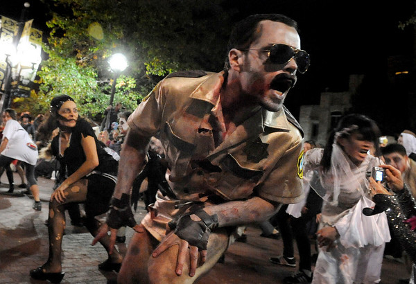 "Mike Procopio, of Boulder performs during Michael Jackson's ""Thriller"" on the Pearl Street Mall in Boulder on Saturday, Oct. 30.<br /> For more photos go to  <a href=""http://www.dailycamera.com"">http://www.dailycamera.com</a><br /> Jeremy Papasso"