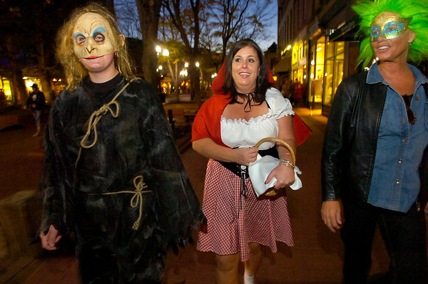 Michael Steves, left, Lesa Morrell and a reveler who asked not to be identified parade in costume for the  Halloween celebration on the Pearl Street Mall on Saturday October 30, 2010. <br /> Photo by Paul Aiken / The Camera