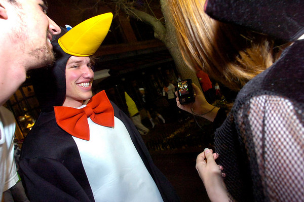 Jordan Towne of Boulder, dressed as a penguin, looks at a photo taken of him during the Halloween celebration on the Pearl Street Mall on Saturday October 30, 2010. <br /> Photo by Paul Aiken / The Camera