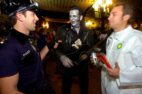 From left to right, Pete Griffin and Richard Stephenson gather before the performance of  Michael Jackson's Thriller on the Pearl Street Mall on Saturday October 30, 2010. <br /> Photo by Paul Aiken / The Camera