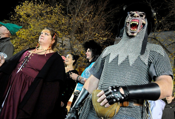 "Jeff Harshberger, right, and Judy Callaway, both of Westminster watch people perform during Michael Jackson's ""Thriller"" on the Pearl Street Mall on Saturday, Oct. 30.<br /> For more photos go to  <a href=""http://www.dailycamera.com"">http://www.dailycamera.com</a><br /> Jeremy Papasso"