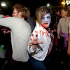 Adam Baraz, left with Jenna Noah, both of Boulder dance together after the performance of  Michael Jackson's Thriller on the Pearl Street Mall on Saturday October 30, 2010. <br /> Photo by Paul Aiken / The Camera