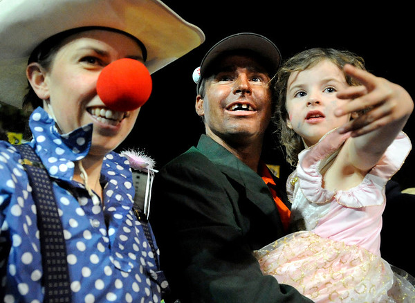 "Molly Higginbottom, left, Clay Thompson and his daughter Kate Marie, all of Boulder smile as they watch others perform to Michael Jackson's ""Thriller"" on the Pearl Street Mall on Saturday, Oct. 30.<br /> For more photos go to  <a href=""http://www.dailycamera.com"">http://www.dailycamera.com</a><br /> Jeremy Papasso"