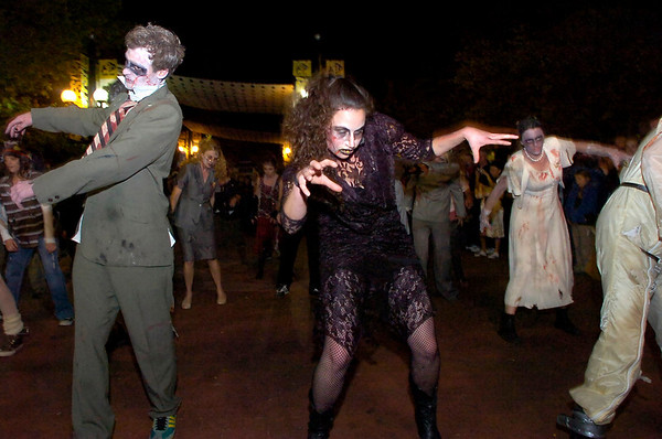 "Karl Thompson, and Tracy Shulsinger, with a group of ""zombies"" perform  Michael Jackson's Thriller on the Pearl Street Mall on Saturday October 30, 2010. <br /> Photo by Paul Aiken / The Camera"