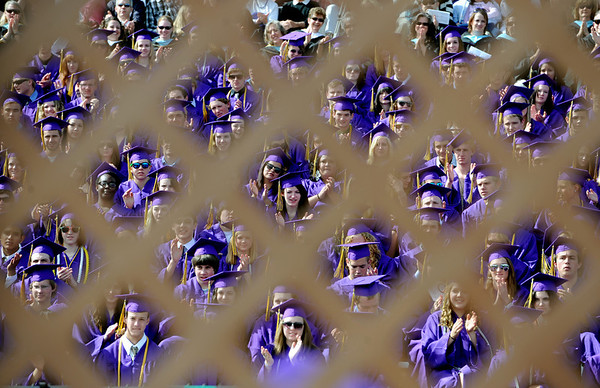 """Boulder High School 2011 graduates are seen through the lattice work   on the stage at Recht Field on Saturday.<br /> For a video and photos of the graduations, go to  <a href=""""http://www.dailycamera.com"""">http://www.dailycamera.com</a>.<br /> Cliff Grassmick/ May 21, 2011"""