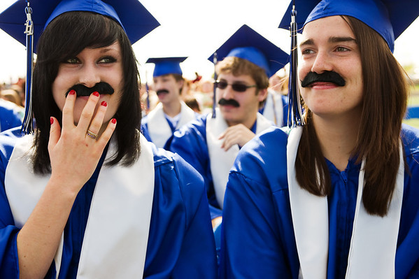 N0522PEAK06.jpg N0522PEAK06<br /> L-R:Rachael Guidetti, Nathan Lawrence and Kelsey Greenough wear fake moustaches in homage to executive principal Anthony Fontana while he delivers is words of wisdom during the Peak To Peak graduation ceremony on Saturday morning May 21st, 2011.<br /> <br /> <br /> Photo by: Jonathan Castner