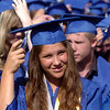 Kayla Baker moves her tassel with the class of 2011 during Saturday's Broomfield High School graduation ceremony at Elizabeth Kennedy Stadium.<br /> May 21, 2011<br /> staff photo/David R. Jennings