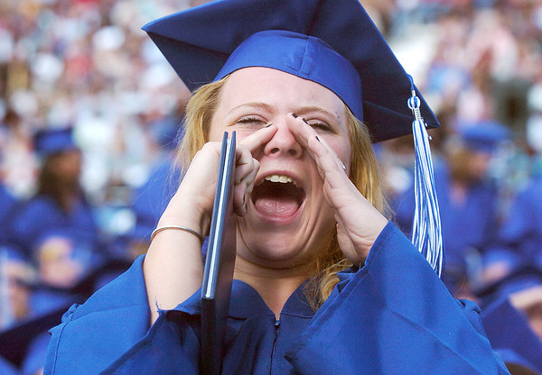Jessica Eatmon cheers for a classmate during Saturday's Broomfield High School graduation ceremony at Elizabeth Kennedy Stadium.<br /> May 21, 2011<br /> staff photo/David R. Jennings
