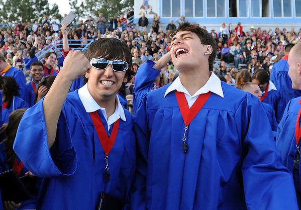 "Dylan Montoya, left, and Matt Montoya, are feeling it after graduating from Centaurus High School on Saturday.<br /> For a video and photos of the graduations, go to  <a href=""http://www.dailycamera.com"">http://www.dailycamera.com</a>.<br /> Cliff Grassmick/ May 21, 2011"