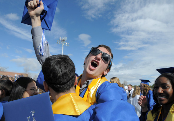 Marc Besson cheers after Saturday's Broomfield High School graduation ceremony at Elizabeth Kennedy Stadium.<br /> May 21, 2011<br /> staff photo/David R. Jennings