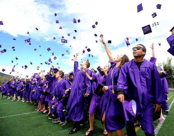 "Lucas Granillo, right, prepares to throw his cap in the air with his 2011 Boulder High School classmates at the end of the ceremony on Saturday.<br /> For a video and photos of the graduations, go to  <a href=""http://www.dailycamera.com"">http://www.dailycamera.com</a>.<br /> Cliff Grassmick/ May 21, 2011"