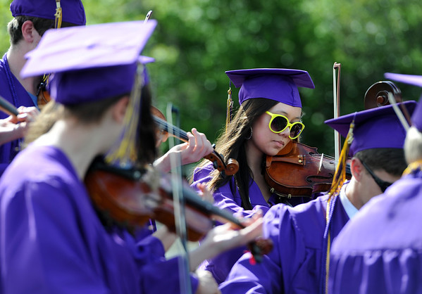 "Linx Selby, middle right, plays one of the graduation songs with other members of the strings group during the Boulder High 2011 graduation on Saturday.<br /> For a video and photos of the graduations, go to  <a href=""http://www.dailycamera.com"">http://www.dailycamera.com</a>.<br /> Cliff Grassmick/ May 21, 2011"