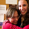 N0522PEAK15.jpg N0522PEAK15<br /> L-R: Chris Mueller hugs her graduate daughter Katie Mueller after the Peak To Peak graduation ceremony on Saturday morning May 21st, 2011.<br /> <br /> <br /> Photo by: Jonathan Castner