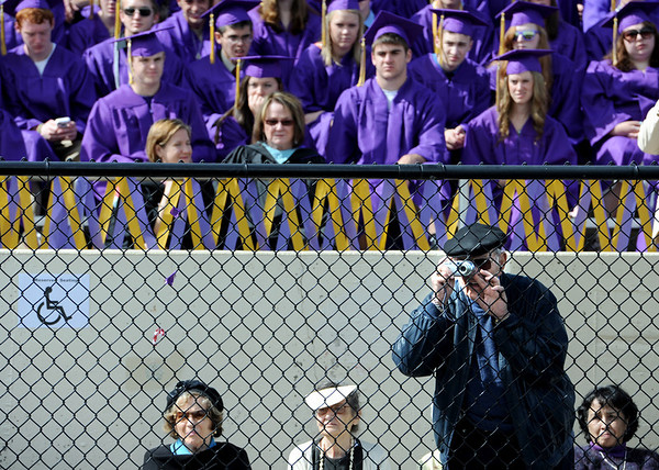 """Dr. George Wyshak positions himself to get a better photo op at the Boulder High School 2011 graduation on Saturday.<br /> For a video and photos of the graduations, go to  <a href=""""http://www.dailycamera.com"""">http://www.dailycamera.com</a>.<br /> Cliff Grassmick/ May 21, 2011"""