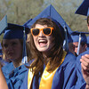 Audery Harris cheers for a classmate who's receiving a diploma during Saturday's Broomfield High School graduation ceremony at Elizabeth Kennedy Stadium.<br /> May 21, 2011<br /> staff photo/David R. Jennings
