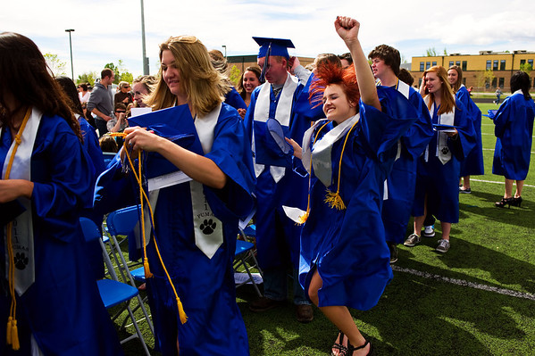 N0522PEAK14.jpg N0522PEAK14<br /> Graduate Megan Jacobs dances to the music at the end of the Peak To Peak graduation ceremony on Saturday morning May 21st, 2011.<br /> <br /> <br /> Photo by: Jonathan Castner