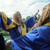 Madison Goering, left, reaches to hug Kayla Baker after Saturday's Broomfield High School graduation ceremony at Elizabeth Kennedy Stadium.<br /> May 21, 2011<br /> staff photo/David R. Jennings