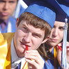 Scott Fiedler chews on a licorice stick during Saturday's Broomfield High School graduation ceremony at Elizabeth Kennedy Stadium.<br /> May 21, 2011<br /> staff photo/David R. Jennings
