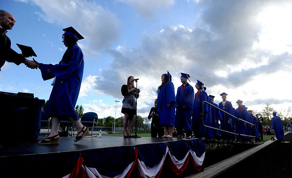 """Centaurus High School seniors line up to receive their diplomas in the early evening hours on Saturday.<br /> For a video and photos of the graduations, go to  <a href=""""http://www.dailycamera.com"""">http://www.dailycamera.com</a>.<br /> Cliff Grassmick/ May 21, 2011"""
