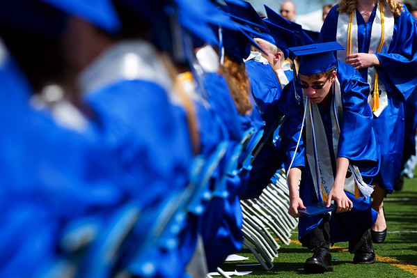 N0522PEAK10.jpg N0522PEAK10<br /> Ethan Lind tries to sneak under the myriad of cameras wielded by the audience of family members during the Peak To Peak graduation ceremony on Saturday morning May 21st, 2011.<br /> <br /> <br /> Photo by: Jonathan Castner