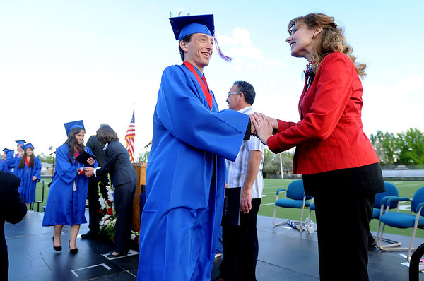 "Centaurus graduate, Aaron Eck, is congratulated by principal, Dr. Rhonda Haniford,  after receiving his diploma.<br /> For a video and photos of the graduations, go to  <a href=""http://www.dailycamera.com"">http://www.dailycamera.com</a>.<br /> Cliff Grassmick/ May 21, 2011"