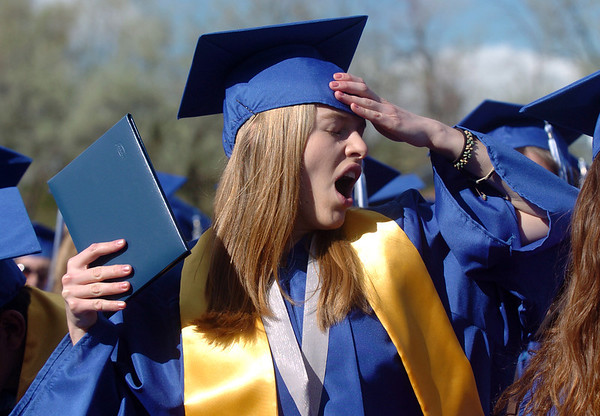 Madison Goering yawns after receiving her diploma at Saturday's Broomfield High School graduation ceremony at Elizabeth Kennedy Stadium.<br /> May 21, 2011<br /> staff photo/David R. Jennings