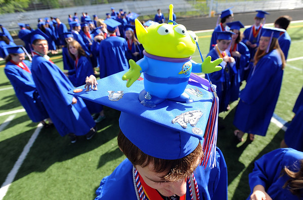 """Mason McNutt is a big fan of Toy Story and a new Centaurus graduate.<br /> For a video and photos of the graduations, go to  <a href=""""http://www.dailycamera.com"""">http://www.dailycamera.com</a>.<br /> Cliff Grassmick/ May 21, 2011"""
