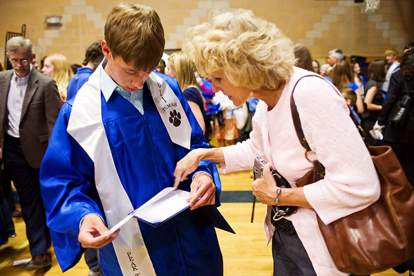 N0522PEAK16.jpg N0522PEAK16<br /> L-R: Jordan Vandenheiden and his mother Stephanie Vandenheiden inspect his diploma after the Peak To Peak graduation ceremony on Saturday morning May 21st, 2011.<br /> <br /> <br /> Photo by: Jonathan Castner