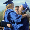 Jessica Eatmon, left, gives Abby Spencer a hug after receiving theri diplomas during Saturday's Broomfield High School graduation ceremony at Elizabeth Kennedy Stadium.<br /> May 21, 2011<br /> staff photo/David R. Jennings