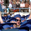 Matt Gleason gives a cheer for a fellow classmate during Saturday's Broomfield High School graduation ceremony at Elizabeth Kennedy Stadium.<br /> May 21, 2011<br /> staff photo/David R. Jennings