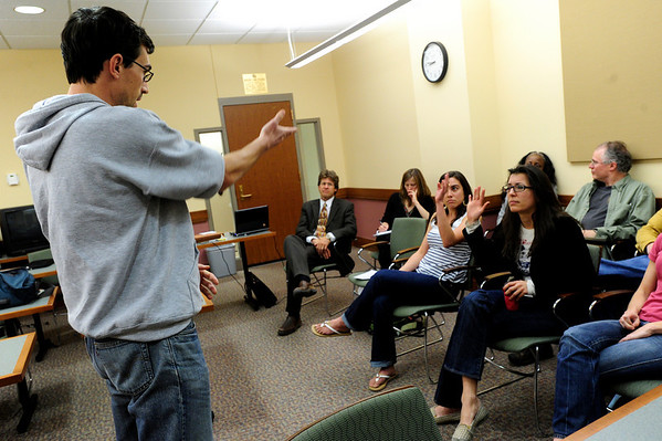 """LAW02.JPG Alex San Filippo-Rosser, left, plays the part of a lawyer questioning potential jurors in a voir dire exercise during a law class at the University of Colorado on Monday. Members of the class are defending homeless people from tickets resulting from the city's """"camping"""" ordinance. For a video about the class, see  <a href=""""http://www.dailycamera.com"""">http://www.dailycamera.com</a>.<br /> Photo by Marty Caivano/April 11, 2011"""