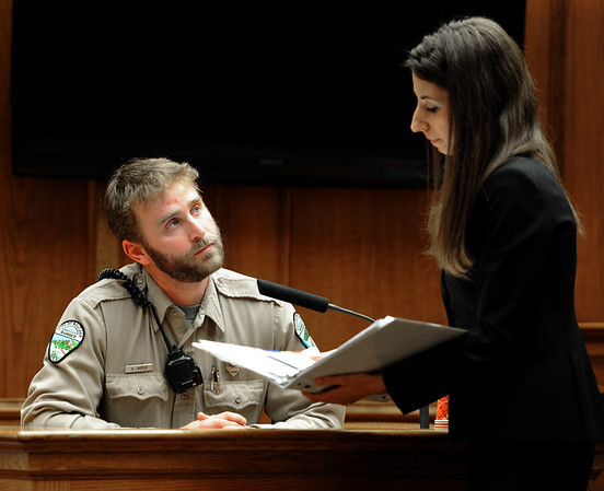 """William Olive Trial28.JPG  Jeff Jasper, ranger for City of Boulder Mountain Parks and Open Space, listen to the questions from Yona Porat of the defense team. Porat and Ann England represented William Olive.<br /> For a video from the defense team, go to  <a href=""""http://www.dailycamera.com"""">http://www.dailycamera.com</a>.<br /> Cliff Grassmick / March 31, 2011"""