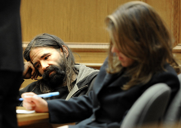 """William Olive Trial24.JPG William Olive listens to a witness in his trial of illegal camping. Attorney, Ann England, is on the right.<br /> For a video from the defense team, go to  <a href=""""http://www.dailycamera.com"""">http://www.dailycamera.com</a>.<br /> Cliff Grassmick / March 31, 2011"""