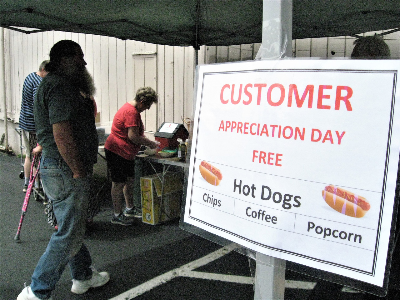 BOB SANDRICK / GAZETTE Saturday was Customer Appreciation Day at ReStore in Medina at 342 East Smith Road. Volunteer  staffers grilled free hot dogs for customers.