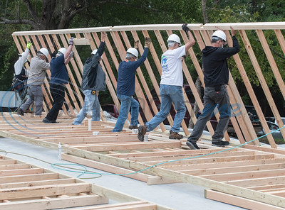 Volunteers from First Presbyterian Church join with Habitat for Humanity staff and volunteers to raise the walls for a home on Shaw Street in Tyler on Saturday, Oct. 17, 2020. First Presbyterian Church is sponsoring this house by donating $50,000 and their members will volunteer over the weekends with the build.