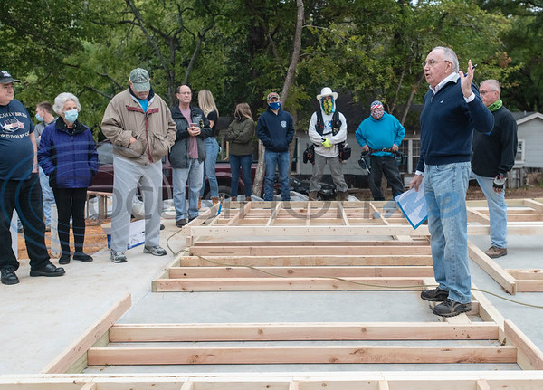 Habitat for Humanity of Smith County CEO Jack Wilson welcomes volunteers to a wall raising on Shaw Street in Tyler on Saturday, Oct. 17, 2020.