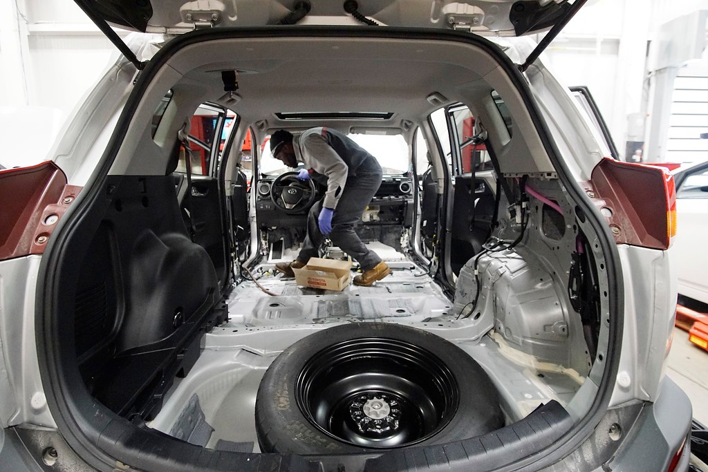 . Jason Dixon rebuilds a car interior at Haddad Motor Group on South Street in Pittsfield, Monday, October 24, 2016. Ben Garver � The Berkshire Eagle