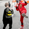 Cash Coyner, 4, shows off his Batman muscles while his brother, Levi, 8, demonstrates his best Power Ranger ninja move for their mom, Katie Coyner's, camera. The family attended the Boone Village Halloween Party Tuesday evening, Oct. 29.