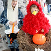 Addison VanGorder, 8, dressed as a dolphin, and Emerson VanGorder, 6, dressed as a redbird in a nest, pose in front of a Halloween backdrop so their mom can take a picture at the Times Sentinel booth during the Boone Village Halloween Party Tuesday evening, Oct. 29. They are the daughters of Janice and Jamie VanGorder.