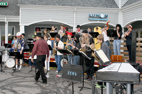 The Zionsville Community High School Jazz Band, complete with Halloween outfits, performs at the Boone Village Halloween Party Tuesday evening, Oct. 29.