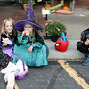 Macy, 4, Madi, 6, and Gavin, 7, VanMatre munch on some hot dogs at the Boone Village Halloween Party Tuesday evening, Oct. 29. Gavin said said his goody bag was almost full of treats, and they hadn't been there very long.