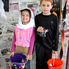 Catherine, 4, and Thomas, 8, Herlt ham it up for a picture at the Times Sentinel booth during the Boone Village Halloween Party Tuesday evening, Oct. 29. Catherine is dressed as an ice cream cone, and Thomas is a spy.