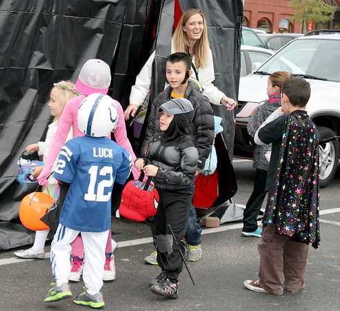 "A group of trick-or-treaters emerge from the ""haunted tent"" at the Boone Village Halloween Party Tuesday evening, Oct. 29. The tent was sponsored by Papa Murphy's Pizza."