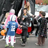 """A group of trick-or-treaters emerge from the """"haunted tent"""" at the Boone Village Halloween Party Tuesday evening, Oct. 29. The tent was sponsored by Papa Murphy's Pizza."""