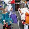 Dressed as a mad scientist, Cole Witmer, 8, and his sister, Adelyn, 5, looking pretty as a peacock, check out the decorated pumpkins at the Boone Village Halloween Party Tuesday evening, Oct. 29. They are the children of Debby and Craig Witmer.