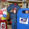 The Busse triplets celebrate their 11th birthday at the Boone Village Halloween Party Tuesday evening, Oct. 29. From left, Annie is trapped in a bubblegum machine; Billy holds his head in a jar; and Lizzie lurks in a mailbox.