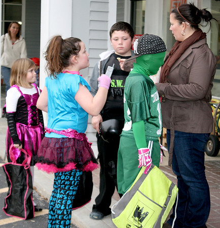 "The Spencer family touches base during the Boone Village Halloween Party Tuesday evening, Oct. 29. Morgan, 12, dressed as an '80s Valley Girl; Chase, 10, was a SWAT officer; Luke, 8, donned green as a Zionsville Eagles fan; and Emma, 9, went as a ""fiesty fairy."" Shannon Spencer, far right, is mom to Morgan, Chase and Emma, and aunt to Luke."