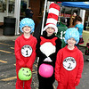 Michael, 7, and Hailey, 8, Minton and Zachary Meek, 6 - aka Thing 1, Cat in the Hat and Thing 2 - pose after visiting the library booth at the Boone Village Halloween Party Tuesday evening, Oct. 29. The trio was having a good time collecting candy.